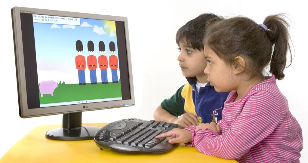 Two children playing a Ben & Betty computer game